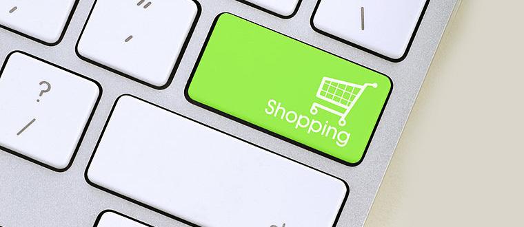 immagine del tasto di una tastiera con il simbolo del carrello e-commerce