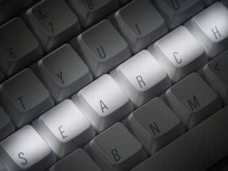 tastiera di un pc con scritto search.