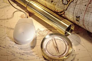 mappa,canocchiale,bussola e mouse - simboleggiando la direzione giusta dove far andare i visitatori.